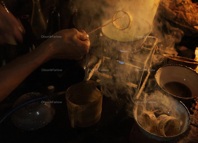 Steam rises from gold bangles as artisanal gold smiths in Kolkata (Calcutta).