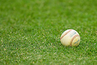A Spaulding baseball sits in the grass at Sims Legion Park prior to the game between the Thomasville HiToms and the Gastonia Grizzlies on June 2, 2011 in Gastonia, North Carolina.  The Hi-Toms defeated the Grizzlies 9-4.  Photo by Brian Westerholt / Four Seam Images