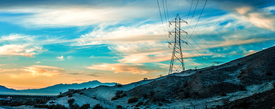 desert landscape with electric poles