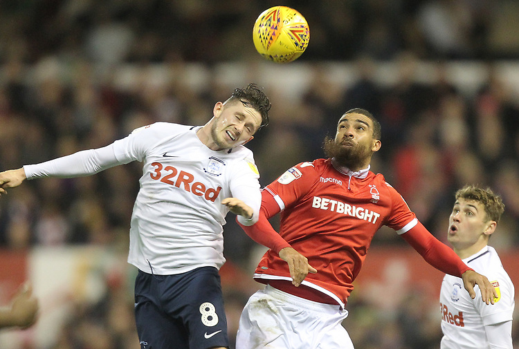 Preston North End's Alan Browne jumps with Nottingham Forest's Lewis Grabban<br /> <br /> Photographer Mick Walker/CameraSport<br /> <br /> The EFL Sky Bet Championship - Nottingham Forest v Preston North End - Saturday 8th December 2018 - The City Ground - Nottingham<br /> <br /> World Copyright © 2018 CameraSport. All rights reserved. 43 Linden Ave. Countesthorpe. Leicester. England. LE8 5PG - Tel: +44 (0) 116 277 4147 - admin@camerasport.com - www.camerasport.com