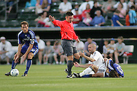 Referee Edvin Jurisevic givs a free kick to The Wizards following  afoul by Brandon Barklage (white) on Santiago Hirsig..Kansas City Wizards and DC United played to a 1-1 draw at Community America Ballpark, Kansas City, Kansas.