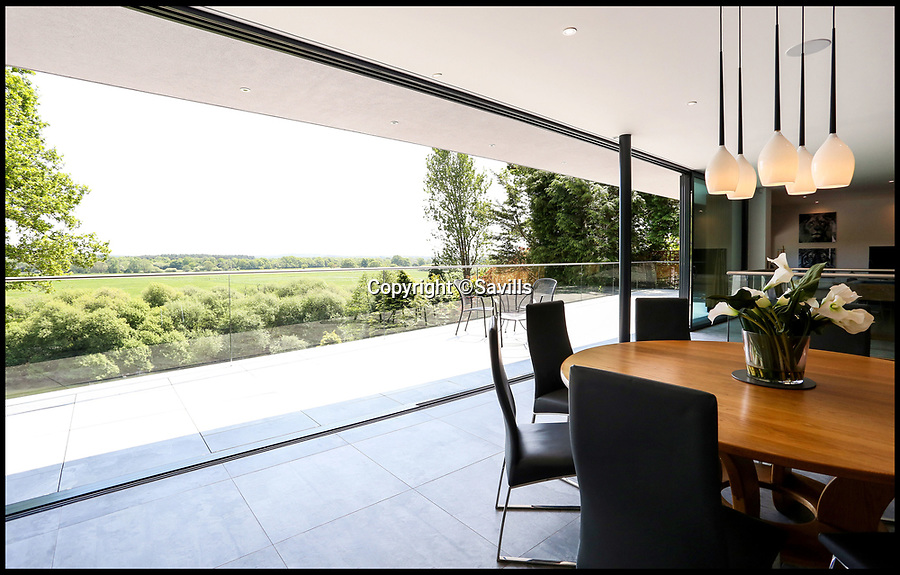 BNPS.co.uk (01202 558833)<br /> Pic: Savills/BNPS<br /> <br /> A James Bond-style contemporary home in a prestigious gated estate that attracts Premiership footballers is on the market for £2.5m.<br /> <br /> The striking 'superhome' in Avon Castle near Ringwood, Hants, has state-of-the-art technology, spectacular countryside views and fishing rights on the River Avon, which is at the bottom of the garden.<br /> <br /> Liverpool midfielder Adam Lallana owns a property in the same road and estate agents Savills say another Premiership footballer has already looked around this house.