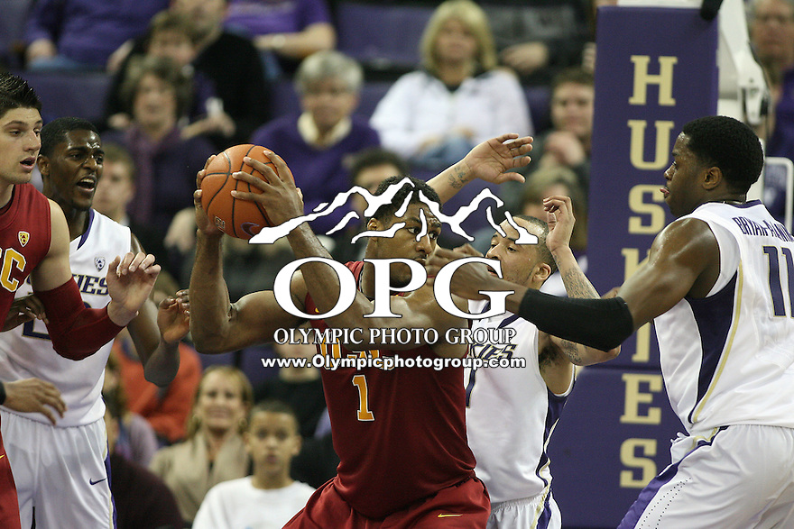 Mar 05, 2011:  USC forward #1 Alex Stepheson looks for an opening to the basket while being guarded by Washington's #1 Venoy Overton and #11 Matthew Bryan-Amaning.  USC defeated Washington 62-60 at Alaska Airlines Arena Seattle, Washington...