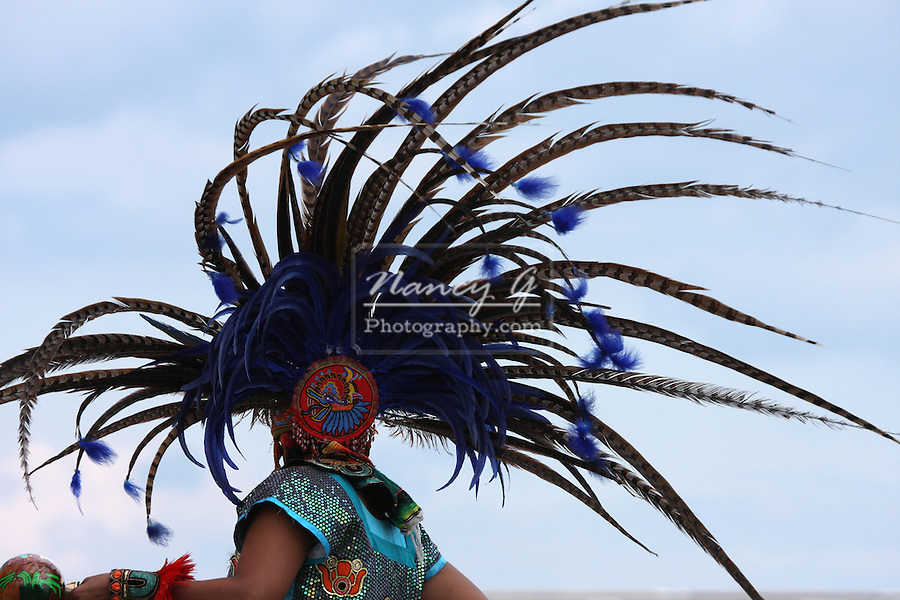 Back of an Incan South American Indian in a fancy feather headdress at the Milwaukee Lakefront Indian Summer Festival, Wisconsin