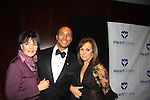 Another World's Linda Dano presents honoree Mike Woods meteorologist with The Linda Dano Heart Award and they pose with Rosanna Scotto (both on Fox 5 Good Day New York) on March 21, 2013 at the HeartShare 25th Annual Spring Gala and Auction at the New York Marriott, NYC, NY.  (Photo by Sue Coflin/Max Photos)