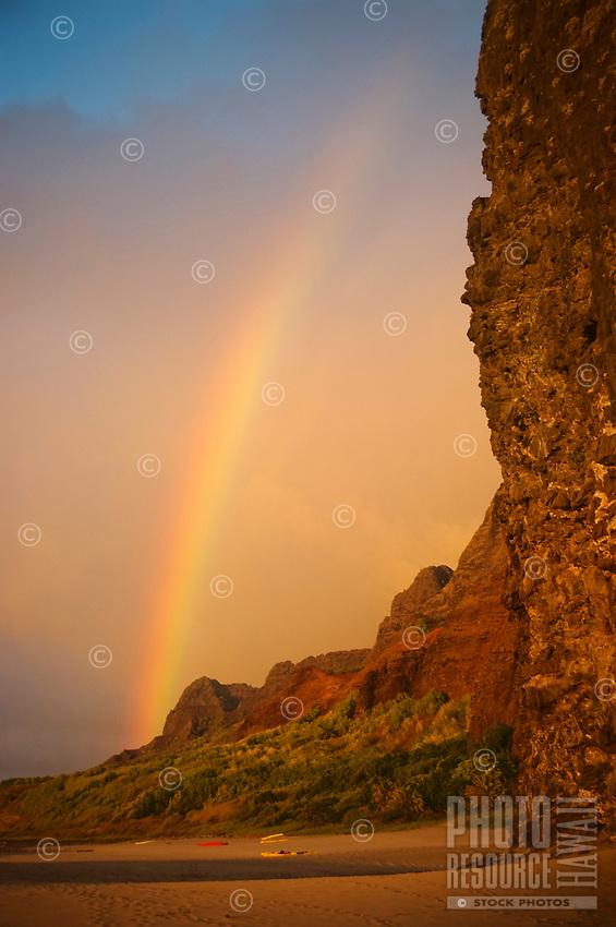A rainbow over Kalalau Beach and cliffs, Na Pali Coast, Kaua'i.