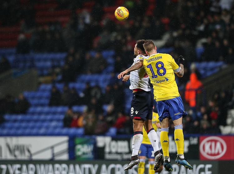 Bolton Wanderers' Josh Magennis competing with Leeds United's Pontus Jansson<br /> <br /> Photographer Andrew Kearns/CameraSport<br /> <br /> The EFL Sky Bet Championship - Bolton Wanderers v Leeds United - Saturday 15th December 2018 - University of Bolton Stadium - Bolton<br /> <br /> World Copyright © 2018 CameraSport. All rights reserved. 43 Linden Ave. Countesthorpe. Leicester. England. LE8 5PG - Tel: +44 (0) 116 277 4147 - admin@camerasport.com - www.camerasport.com