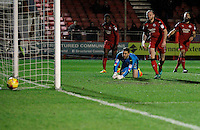 Exeter City's Ollie Watkins scores as Crawley Town's Glenn Morris can only watch the ball nestle behind him during the Sky Bet League 2 match between Crawley Town and Exeter City at Broadfield Stadium, Crawley, England on 28 February 2017. Photo by Carlton Myrie / PRiME Media Images.