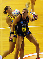 Leana De Bruin fouls Jodi Brown during the ANZ Netball Championship match between the Central Pulse and Waikato Bay Of Plenty Magic at TSB Bank Arena, Wellington, New Zealand on Monday, 30 March 2015. Photo: Dave Lintott / lintottphoto.co.nz