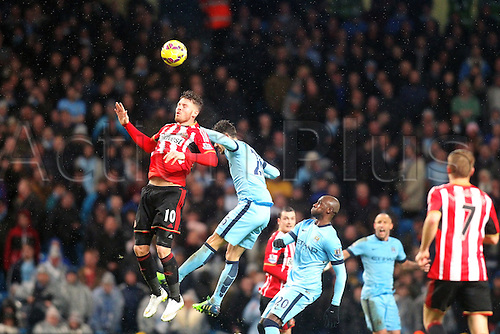 01.01.2015.  Manchester, England. Barclays Premier League. Manchester City versus Sunderland. Sunderland forward Connor Wickham wins a header