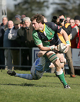 Ballynahinch second row Chris Napier on the attack is tackled by Lorcan Bourke during the AIB Cup semi-final against Garryowen at Ballymacarn Park, Ballynahinch. Mandatory Credit - John Dickson