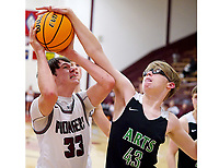 Westside Eagle Observer/RANDY MOLL<br /> Gentry's Garrison Jackson attempts a shot under the basekt but his shot is blocked by Luke Seay of Arkansas Arts Academy on Nov. 19 at Gentry High School.