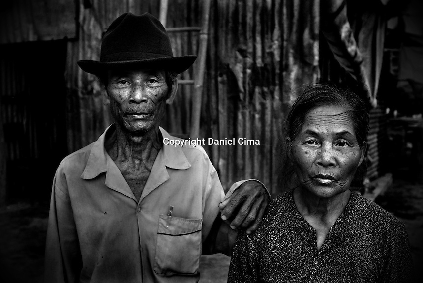 Portrait of a couple (typhoon survivors) at home in .Da-Nang, The Socialist Republic of Vietnam. May 2007