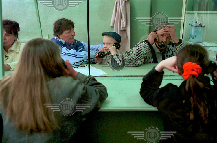 Prisoners talk to their loved ones during visitation at a women's penal colony near Novosibirsk.