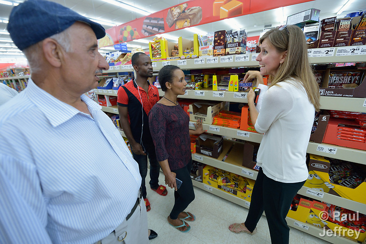 Penny Gushiken (right) leads a cultural orientation class for newly arrived refugees in Lancaster, Pennsylvania. During a visit to a supermarket, participants discuss available food items, including candy. The class is sponsored by Church World Service. <br /> <br /> Photo by Paul Jeffrey for Church World Service.