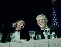 ***FILE PHOTO*** George H.W. Bush Has Passed Away<br /> Washington, DC., USA, April 29, 1989<br /> President George H.W. Bush attending the annual White House Corrsepondents Association Dinner, laughs as Impressionist Jim Morris began his Bush bit in silence &ntilde; just moving his head, sort of stammering, trying to get some words out. The president [Bush], watching Morris do his inarticulate-thing, started laughing hard, finally held his big white dinner napkin over his face. To the President's left is Jememiah O'Leary that year's WHCA president. <br /> CAP/MPI/MRN<br /> &copy;MRN/MPI/Capital Pictures