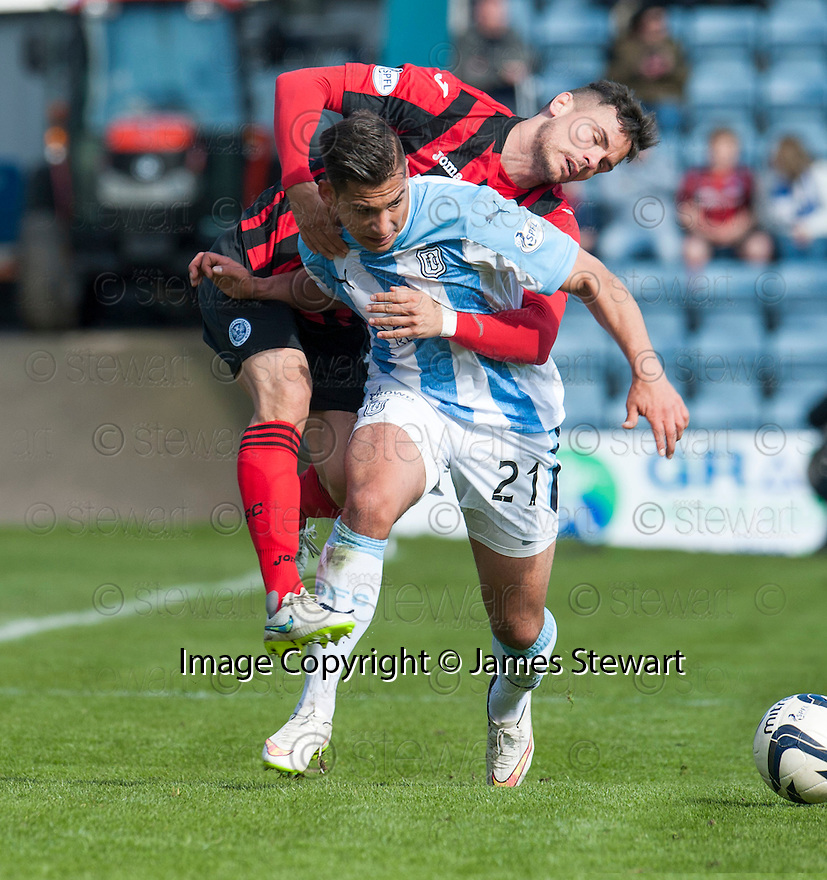Dundee's Luka Tankulic barges in to St Johnstone's Gary Miller.