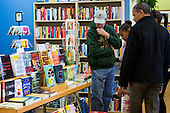 "United States President Barack Obama shops at One More Page Books in Arlington, Virginia on Small Business Saturday, November 24, 2012. .Credit: Kristoffer Tripplaar  / Pool via CNP..Pool Report 1: Motorcade left the South Lawn [of the White House] at 1:02 p.m. and arrived in Arlington, Virginia, at One More Page Books at 1:15 p.m. for an OTR (Off the Record) Small Business Saturday event with Sasha and Malia.  From the door of the small book shop, which the White House described as an ""independent, neighborhood bookstore,"" POTUS (President of the United States) could be seen holding up his BlackBerry, apparently looking up a title, as he spoke with shop owner Eileen McGervey. ""Preparation,"" the president said. ""That's how I shop.""  Wearing a dark windbreaker against the blustery weather outside, POTUS handed off a stack of about 10 books to the clerk -- pool was too far away to read titles -- (will send in a later report if we get them) and then shook hands with several employees. He then began to wander through the business with his daughters as pool was escorted out.  ""We're doing Christmas shopping,"" POTUS said to a question from the pool about the fiscal cliff. ""Happy Thanksgiving, folks.""  POTUS emerged about 10 minutes later to shake hands for a few minutes with two small groups that formed outside the shop on the sidewalk."