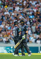 Martin Guptill, right, congratulates Colin Munro on his 50 during the Black Caps v Australia international T20 cricket match at Eden Park in Auckland, New Zealand. 16 February 2018. Copyright Image: Peter Meecham / www.photosport.nz