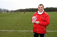 Brendan Rodgers receives an award for best performance of the week, presented to him by a tv crew from Sky Sports at the clubs training ground today, 16/03/12<br /> Picture by: Ben Wyeth / Athena Picture Agency<br /> info@athena-pictures.com
