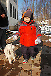 The dog follows along as she watches Alex on his first day in the snow with the family December 2009.