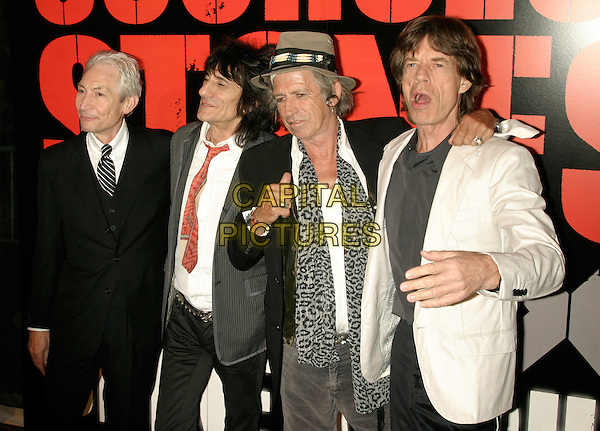 "THE ROLLING STONES - CHARLIE WATTS, RONNIE WOOD, KEITH RICHARDS & MICK JAGGER .New York Premiere of ""Shine A Light"" at the Ziegfeld Theater, New York, NY, USA..March 30th, 2008.half length black white grey gray pinstripe suit jacket hat mouth open leopard print scarf .CAP/LNC/TOM.©TOM/LNC/Capital Pictures."