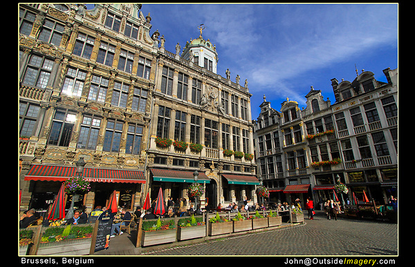 Belgium, Brussels.  <br /> Don't photograph buildings straight on. Compose to create diagonal lines to lead the viewer into your photo.  Generally, you want to see the front and a side, whether a building or a box. Restaurants in the Grand Place of Brussels.