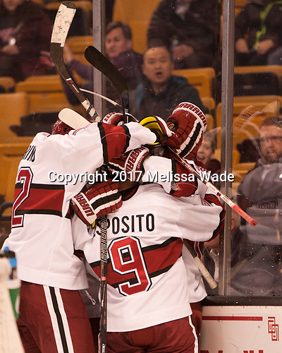 John Marino (Harvard - 12), Luke Esposito (Harvard - 9), Alexander Kerfoot (Harvard - 14) - The Harvard University Crimson defeated the Northeastern University Huskies 4-3 in the opening game of the 2017 Beanpot on Monday, February 6, 2017, at TD Garden in Boston, Massachusetts.