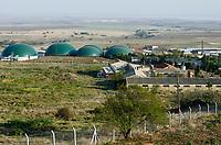 TURKEY Bandirma, Edincik, 2.1 MW biogas plant of company Telko where chicken dung from surrounded chicken farms is fermented to gas which is used for generation of electric power, biogas plant was installed by german company Bioconstruct / TUERKEI Bandirma, Edincik, 2.1 MW Biogasanlage der Firma Telko, hier wird Huehnermist von umliegenden Huehnereier Legebatterien zu Biogas und Strom, die Anlage wurde von der deutschen Firma BioConstruct errichtet, Blick auf Biogasanlage und Huehnerstaelle
