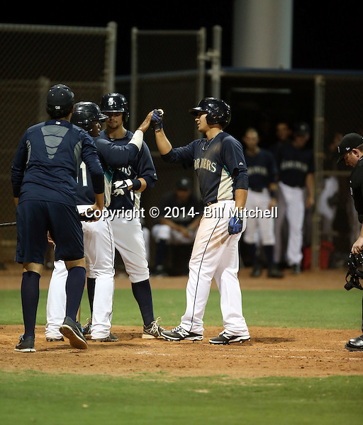 Alex Jackson, the Seattle Mariners 2014 1st round draft choice, hits his first professional homerun in an Arizona League game against the AZL Reds at Peoria Sports Complex on July 7, 2014 in Peoria, Arizona (Bill Mitchell)