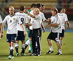 Gordon Strachan and Stuart McCall congratulate their players on the park after victory in Macedonia