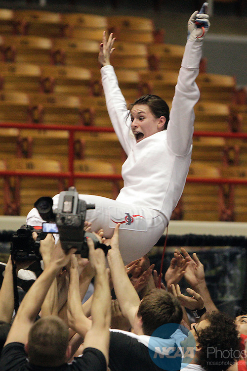 23 MAR 2012:  Katarzyna Dabrowa of Ohio State is tossed in the air after beating Margherita Guzzi Vincenti of Penn State in the epee competition of the Division I Women's Fencing Championship held at St. John Arena on the Ohio State University campus in Columbus, OH. Dabrowa defeated Guzzi Vincenti 15-14 to claim the national title.  Jay LaPrete/ NCAA Photos