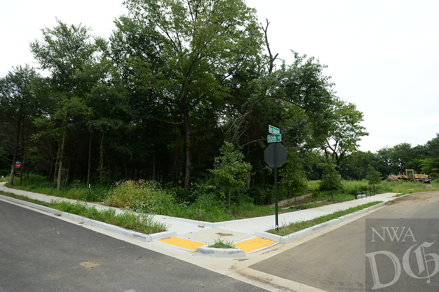 NWA Democrat-Gazette/ANDY SHUPE<br /> A street sign marks the intersection of Bee Balm Avenue and 10th Street Tuesday, Aug. 13, 2019, at the Homes at Willow Bend project, a development by Partners for Better Housing.The project involves building about 80 homes for families of mixed incomes with affordable financing available. It broke ground in 2017.