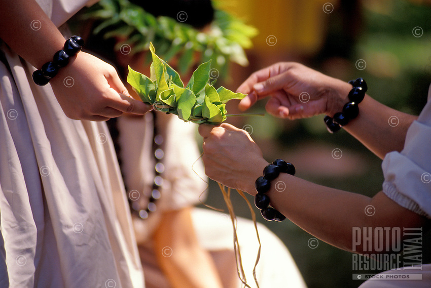 Lei making as preparation for a hula performance at the Ka Hula Piko Festival on Molokai