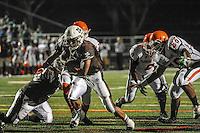 Mt. Carmel running back Matt Domer breaks free for a touchdown on the Caravan's third possession against Morgan Park Friday night