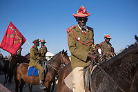 OTJIWARONGO, NAMBIA- AUGUST 12: Herero men dressed in traditional military uniforms during a march when commemorating fallen chiefs killed in battles with Germans. The area was the venue for decisive battles of the Herero uprisings in 1904.  The Herero accuse the German Empire of Genocide of its people from 1904-07. They are currently trying to make the German government compensate the descendants of the people killed.<br /> (Photo by Per-Anders Pettersson)