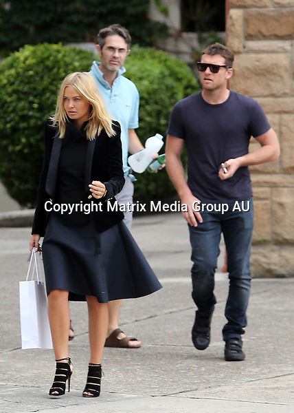 21 JANUARY 2014 SYDNEY AUSTRALIA<br /> <br /> EXCLUSIVE PICTURES<br /> <br /> Lara Bingle pictured with her boyfriend or perhaps husband Sam Worthington out and about in Sydney The loved up couple are fresh back from a holiday / honeymoon in the Maldives. Sam escorted Lara to a meeting in Surry Hills followed by a visit to Lara's lawyer in the lead up to her court appearance for driving offences (alleged) Sam is seen wearing a simple gold band on his ring finger providing the first evidence of the couples marriage.