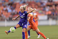 Houston, TX - Friday May 20, 2016: Kaylyn Kyle (6) of the Orlando Pride gains control of a loose ball with Denise O'Sullivan (13) of the Houston Dynamo behind her. The Orlando Pride defeated the Houston Dash 1-0 during a regular season National Women's Soccer League (NWSL) match at BBVA Compass Stadium.