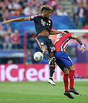 Atletico de Madrid's Augusto Fernandez (r) and FC Bayern Munchen's Kingsley Coman during Champions League 2015/2016 Semi-Finals 1st leg match. April 27,2016. (ALTERPHOTOS/Acero)