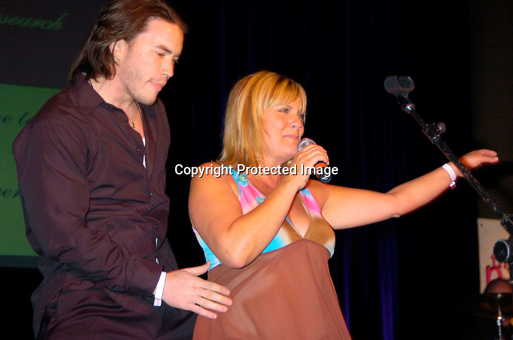 Tom Pelphrey and Kim Zimmer singing ..at the 10th Annual Daytime Television Salutes St. Jude Children's Research Hospital Benefit on October 8, 2004 at the Marriott Marquis Hotel in New York City...Photo by Robin Platzer, Twin Images