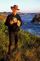 California, Mendocino, Man with wild mushrooms