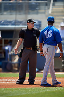 Dunedin Blue Jays manager Cesar Martin (16) argues a call with umpire Brandon Blome during a Florida State League game against the Charlotte Stone Crabs on April 17, 2019 at Charlotte Sports Park in Port Charlotte, Florida.  Charlotte defeated Dunedin 4-3.  (Mike Janes/Four Seam Images)