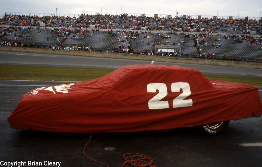 Bobby Allison 22 car covered on pit road before Busch Clash at Daytona International Speedway in Daytona Beach, FL on February  1984. (Photo by Brian Cleary/www.bcpix.com)