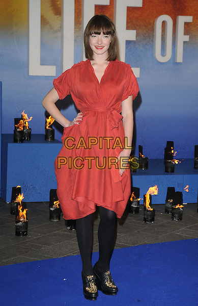 Dakota Blue Richards.'The Life Of Pi' UK film premiere, Empire cinema, Leicester Square, London, England.3rd December 2012.full length leopard print shoes black tights red dress hand on hip.CAP/CAN.©Can Nguyen/Capital Pictures.
