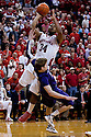 23 February 2011: Lance Jeter #34 of the Nebraska Cornhuskers drove the whole court and over Will Spradling #55 of the Kansas State Wildcats for the foul late during the second half at the Devaney Sports Center in Lincoln, Nebraska. Kansas State defeated Nebraska 61 to 57.