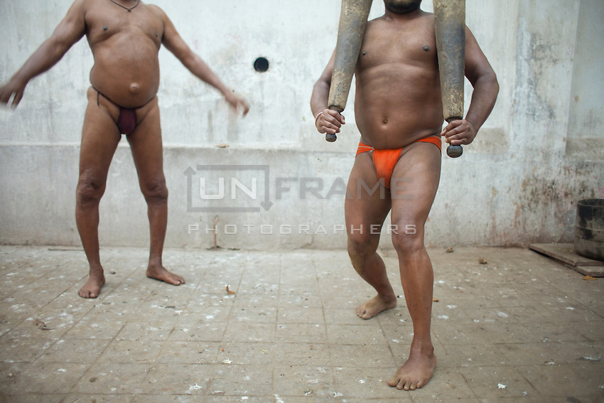 Jawla Trwatri is a Pehlwan, an Indian wrestler. He practices the ancient art of fight with his friends in a martial Akhara, a training hall for professional fighters. <br /> pehlwani are traditional mud wrestlers. Nowadays, there are a few wrestlers remained that choose to play traditional Kushti wrestling in the mud rather than on the mat or on the turf. Kolkata, India.