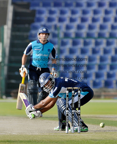 T20 World Cup Qualifying match - Scotland V Namibia at the Sheikh Zayed Stadium - Abu Dhabi - Scotland had a late flurry of runs thanks to a useful 27 from Majid Haq (supported here by Fraser Watts) - Scotland lost by 49 runs - Picture by Donald MacLeod  14.3.12  07702 319 738  clanmacleod@btinternet.com