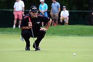 Bethesda, MD - June 24, 2016: Patrick Reed studies the green before attempting a putt on the #1 green during Round 2 of professional play at the Quicken Loans National Tournament at the Congressional Country Club in Bethesda, MD, June 24, 2016.  (Photo by Don Baxter/Media Images International)