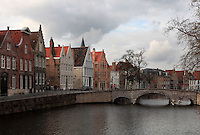 BRUGES, BELGIUM - FEBRUARY 08 : A general view of the typical residential houses along a canal with bridge on February 08, 2009 in Bruges, West Flanders, Belgium. Only the red tile roofs of the houses shine in the middle of the heavy cloudy sky. (Photo by Manuel Cohen)