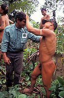 Anthropologist from FUNAI ( Brazilian National Indian Foundation ) doing field work in the Amazon rainforest - First contact with Korubo indigenous people - Brazil -  The group calls themselves 'Dslala', and in Portuguese they are referred to as caceteiros (clubbers). Much of what the outside world knows of this group is based on the research of Brazilian explorer Sydney Possuelo who first contacted the tribe in October 1996 - The Korubo are some of the last people on Earth to live in near isolation from modern society although they have on numerous occasions had violent contacts with the surrounding. Vale do Javari Indigenous Land, Amazonas State, Brazil.